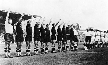 Italy's team perform the fascist salute in 1938